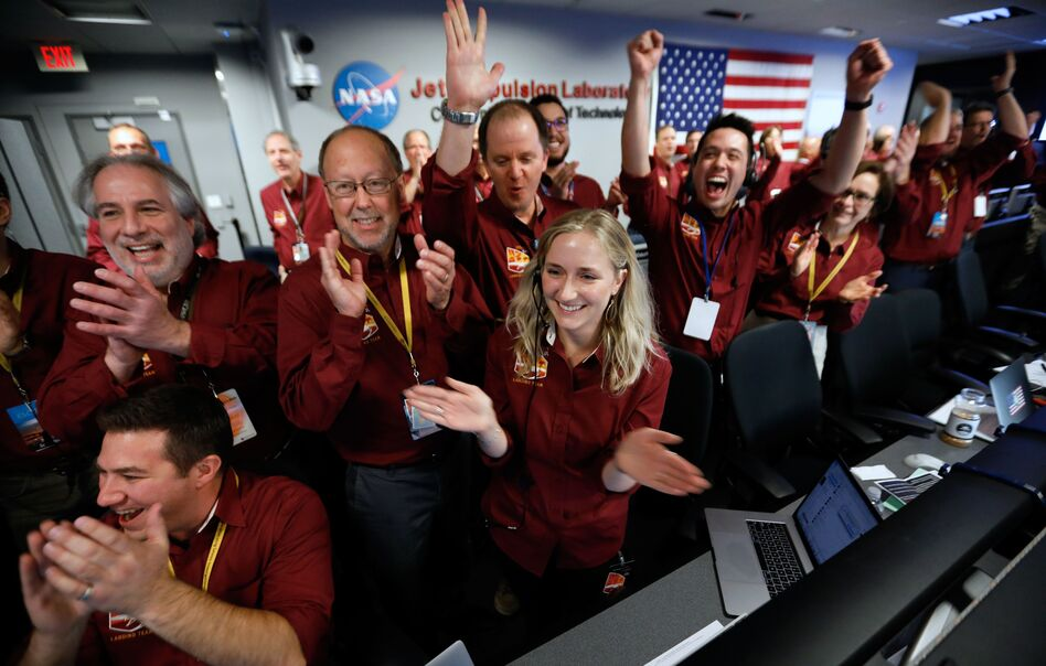 NASA engineers on the flight team celebrate the InSight spacecraft's successful landing on Mars at the NASA Jet Propulsion Laboratory in Pasadena, Calif., on Monday. (Al Seib/AFP/Getty Images)
