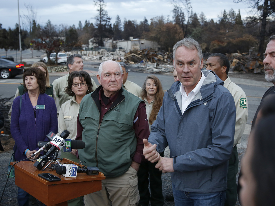 Interior Secretary Ryan Zinke, right, answers a reporters question after touring fire ravaged Paradise, Calif. with Agriculture Secretary Sonny Perdue, center. The pair advocated more aggressive forest management policies to mitigate damage from future wildfires. (Rich Pedroncelli/AP)