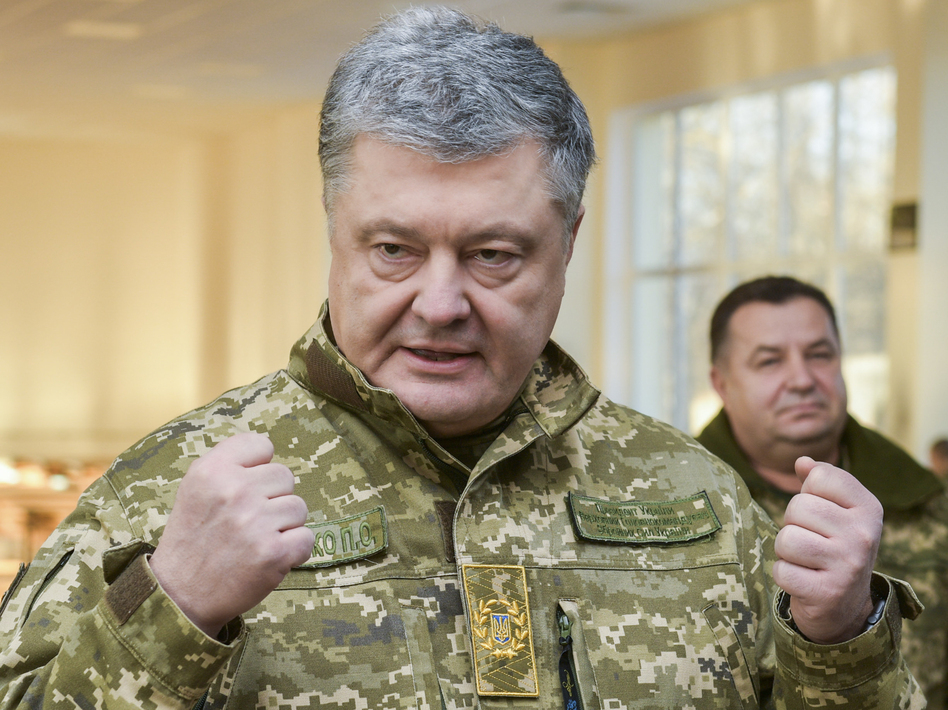 Ukrainian President Petro Poroshenko speaks to soldiers during a visit to a military base in Chernihiv region, Ukraine, on Wednesday. Russia and Ukraine traded blame after Russian border guards on Sunday opened fire on three Ukrainian navy vessels and eventually seized them and their crews. The incident put the two countries on a war footing and raised international concern. (Mykola Lazarenko/Presidential Press Service via AP)