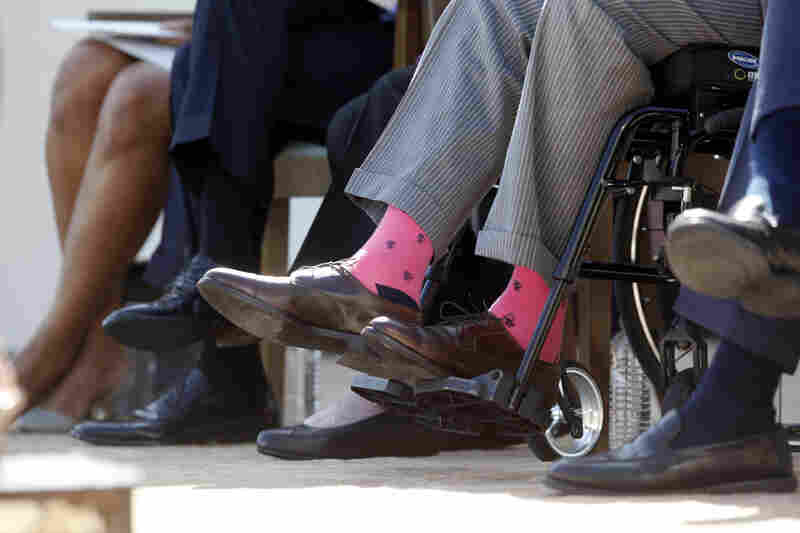 Former President George H.W. Bush wears pink socks as he sits in a wheelchair at the inauguration of the George W. Bush Presidential Library on the campus of Southern Methodist University in Dallas on April 25, 2013.
