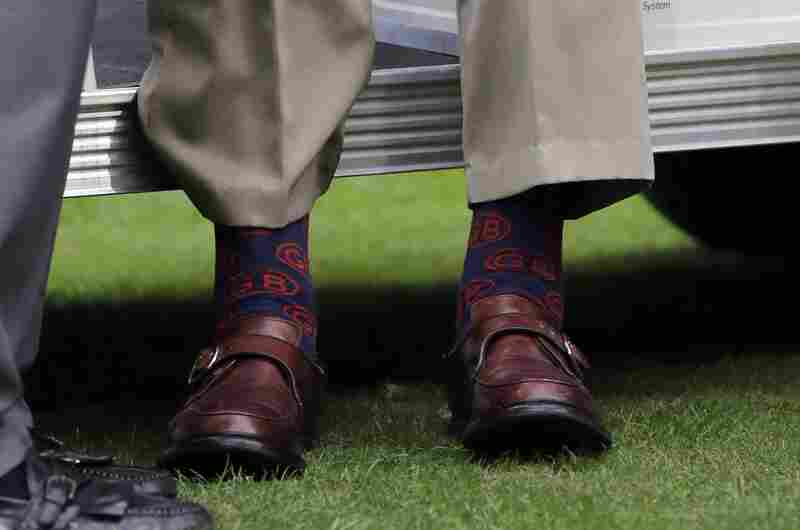 Bush's socks can be seen at an NFL football match between the Houston Texans and the Oakland Raiders on November 17, 2013 in Houston.