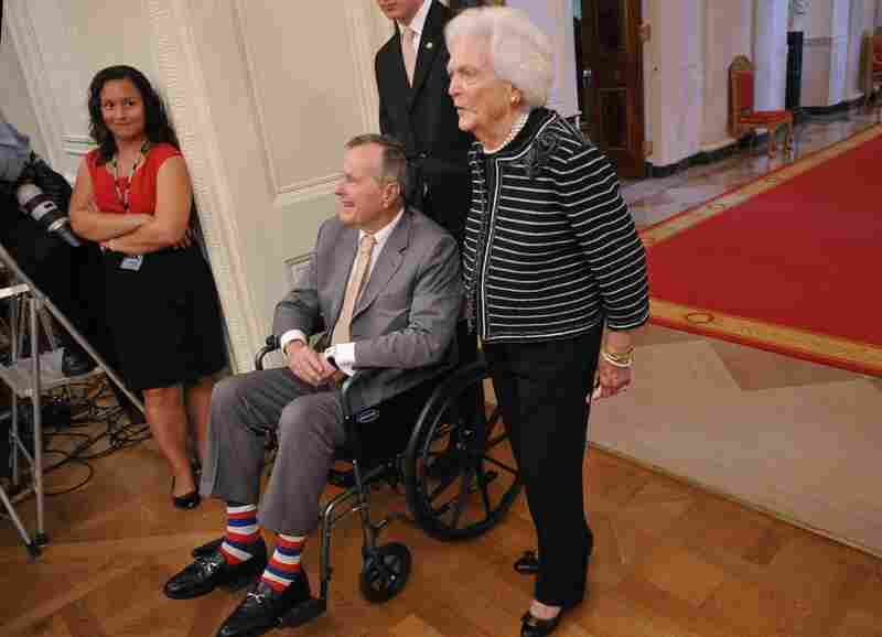 George H.W. Bush and his wife Barbara visit the unveiling of former President George W. Bush and his wife Laura Bush at the White House on May 31, 2012.