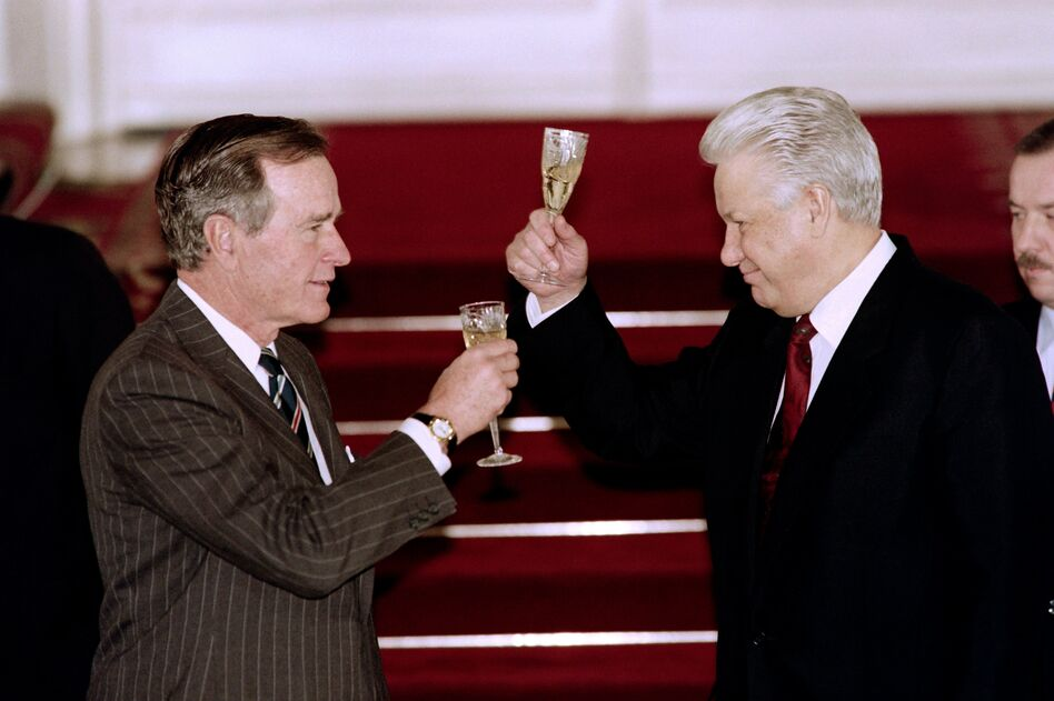 President George H.W. Bush and Russian President Boris Yeltsin toast to each other after signing an arms control treaty in January 1993 in Moscow. Bush skillfully cultivated relationships with both Yeltsin and his Soviet predecessor, Mikhail Gorbachev. (David Ake/AFP/Getty Images)