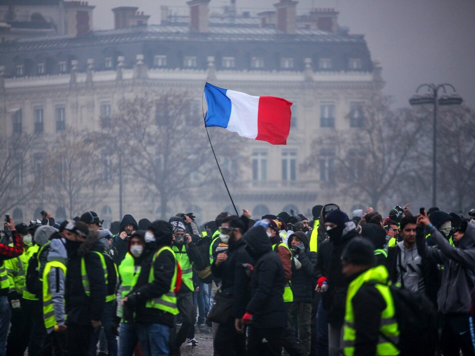 Demonstrators gather near the Arc de Triomphe in Paris during a protest on Saturday. (AFP/Getty Images)