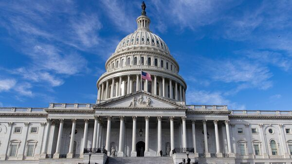 The U.S. flag flies at half-staff in honor of former President George H.W. Bush outside the Capitol in Washington, D.C., Monday. Top Hill leaders planned on a stopgap funding bill to avoid a partial shutdown at the end of the week.