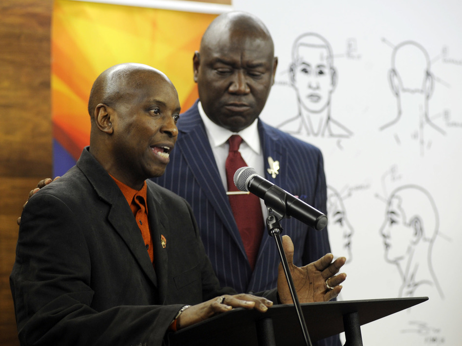 Emantic Bradford Sr. (left) discusses the results of a forensic examination on his son, EJ, who was fatally shot by police on Thanksgiving. Flanked by attorney Ben Crump, the elder Bradford addressed a news conference Monday in Birmingham, Ala. (Jay Reeves/AP)