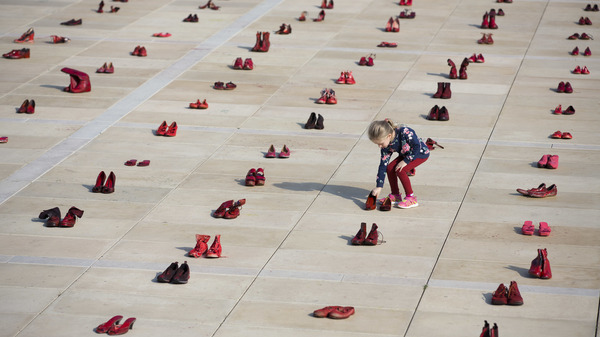Hundreds of red shoes filled Tel Aviv