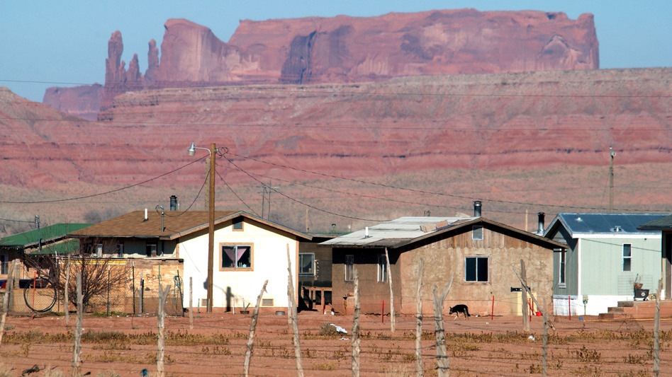 Houses on the Navajo Nation sit near sandstone cliffs north of Many Farms, Ariz. New Census Bureau estimates show a low rate of high-speed internet access among Native Americans who live on tribal land. (David McNew/Getty Images)