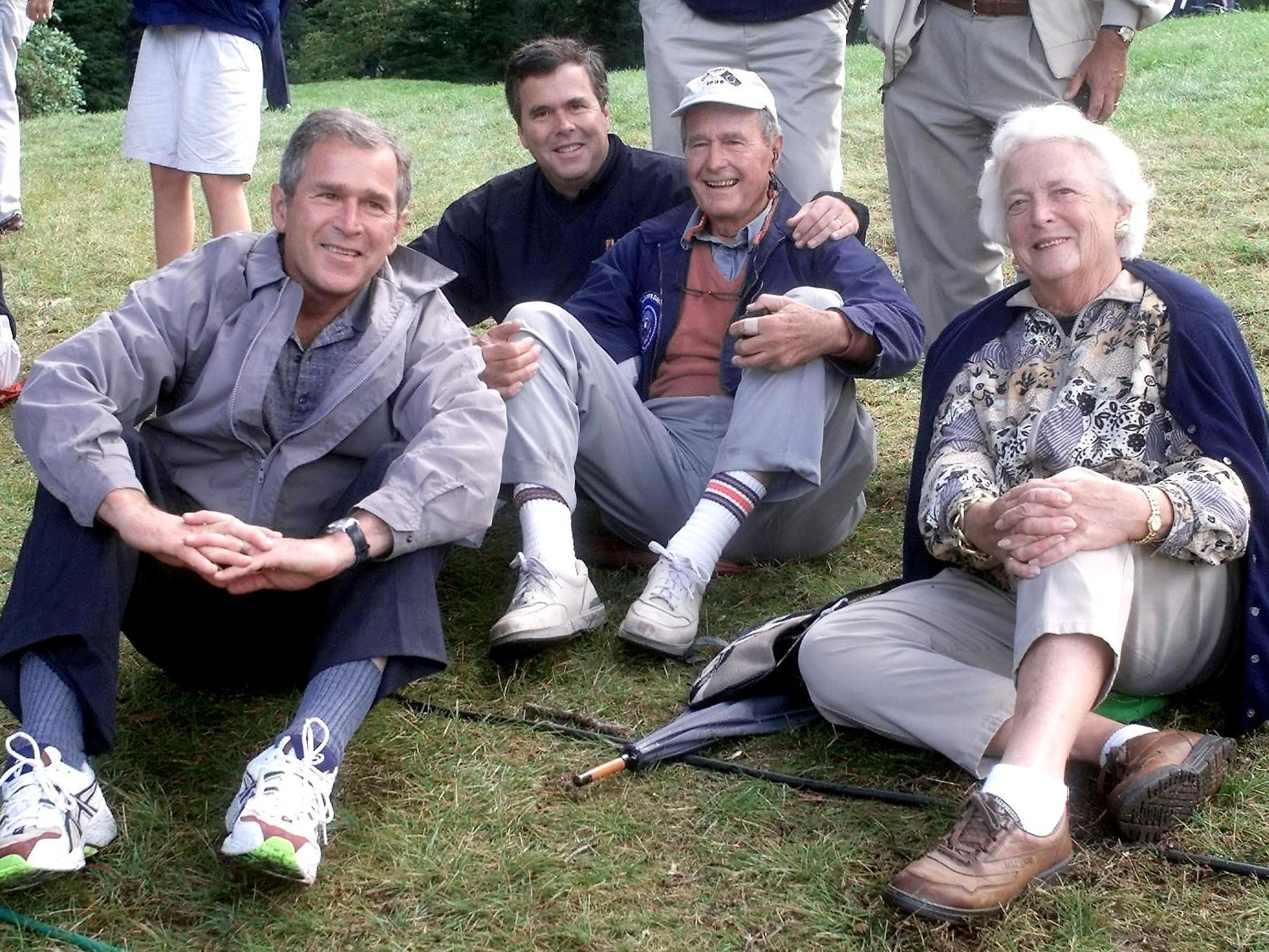 George W. Bush, Jeb Bush, former President George H.W. Bush and his wife Barbara Bush in September 1999 at the Ryder Cup in Brookline, Mass. (John Mottern/AFP/Getty Images)
