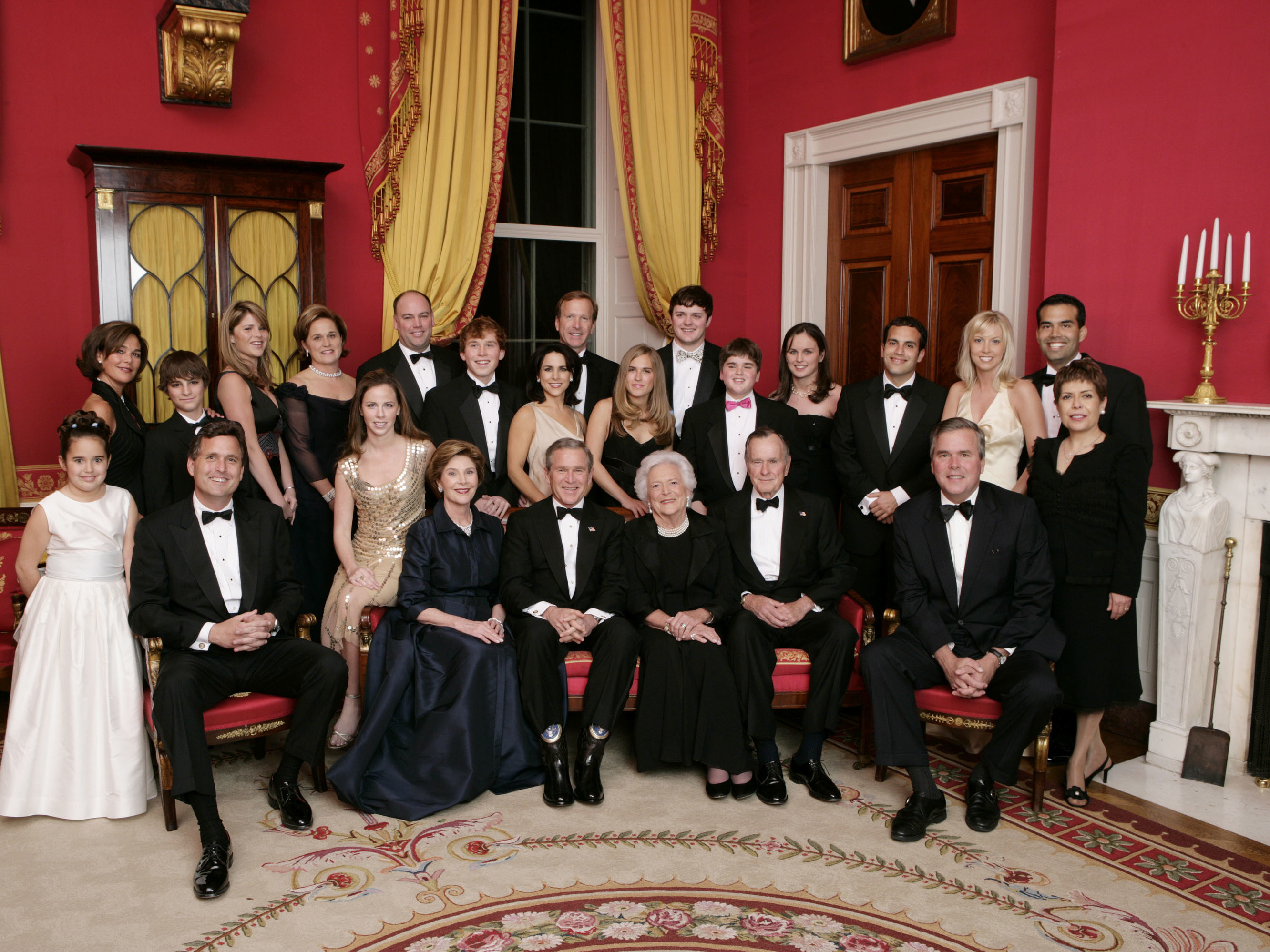 Then-President George W. Bush, then-first lady Laura Bush, former first lady Barbara Bush and former President George H.W. Bush sit surrounded by family in the Red Room of the White House on Jan. 6, 2005, in Washington, D.C. Friends and family joined former President Bush and Barbara Bush in celebrating their 60th wedding anniversary at a dinner. (The White House/Getty Images)