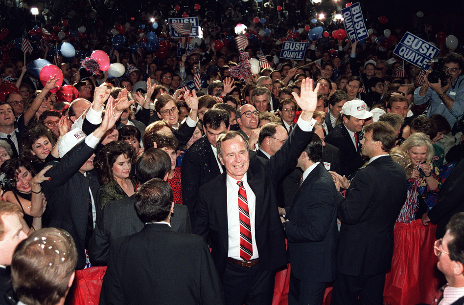 George Bush wades through a crowd in Houston after his victory speech in the 1988 presidential election. (Mike Spague/AFP/Getty Images)