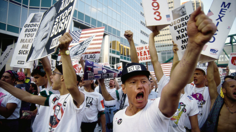 ACT UP demonstrators shout and carry posters outside the 1992 Republican National Convention.