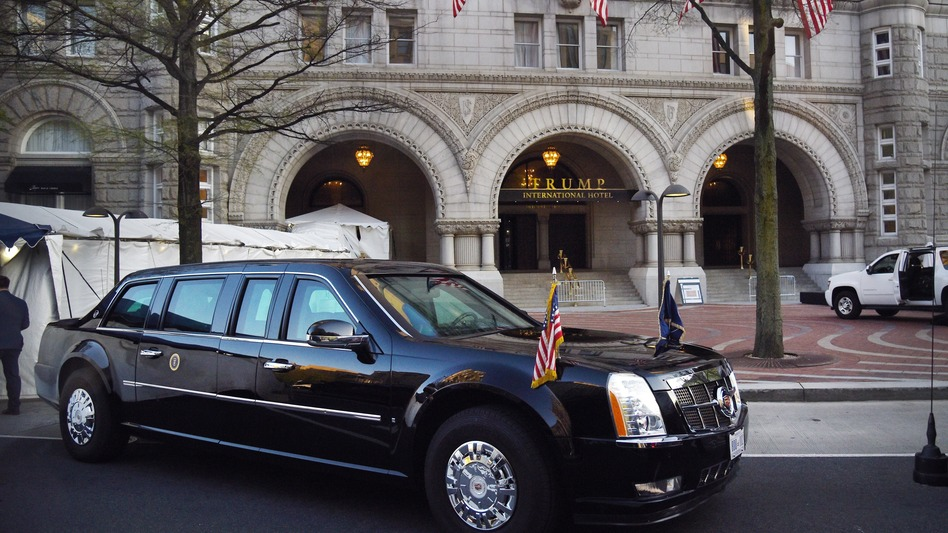 """The presidential limousine, aka """"The Beast,"""" is parked in front of the Trump International Hotel as President Trump attends dinner with supporters on April 30 in Washington, D.C. (Olivier Douliery/Pool/Getty Images)"""