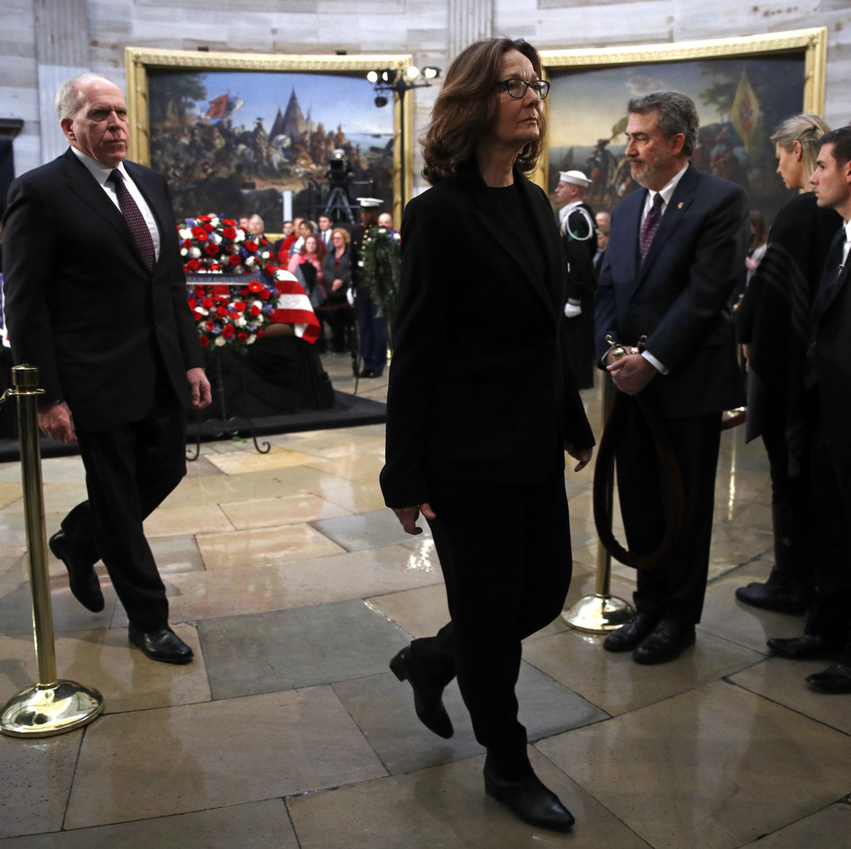 CIA Director Gina Haspel departs the Capitol Rotunda after visiting the flag-draped casket of former President George H.W. Bush as he lies in state in Washington. (Patrick Semansky/AP)