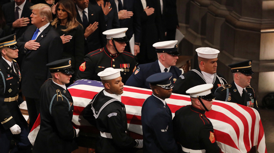 A military honor guard carries the casket of former President George H.W. Bush during the funeral at the National Cathedral in Washington, D.C. (Cheryl Diaz Meyer for NPR)
