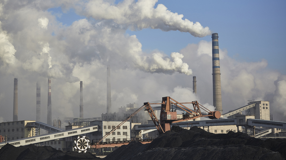Thick clouds emanate from a coal-burning power plant in Baishan, in the Jilin province of China. In an effort to boost its economy, China has recently started greenlighting coal projects that had been on hold. (Christian Petersen-Clausen/Getty Images)