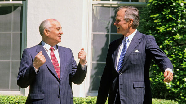 Soviet President Mikhail Gorbachev (left) and former U.S. President George H.W. Bush share a light moment together outside the White House in 1990. Could they be discussing chicken?