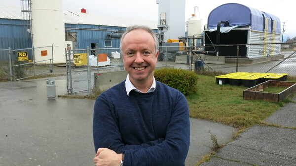 Carbon Engineering CEO Steve Oldham stands in front of the company