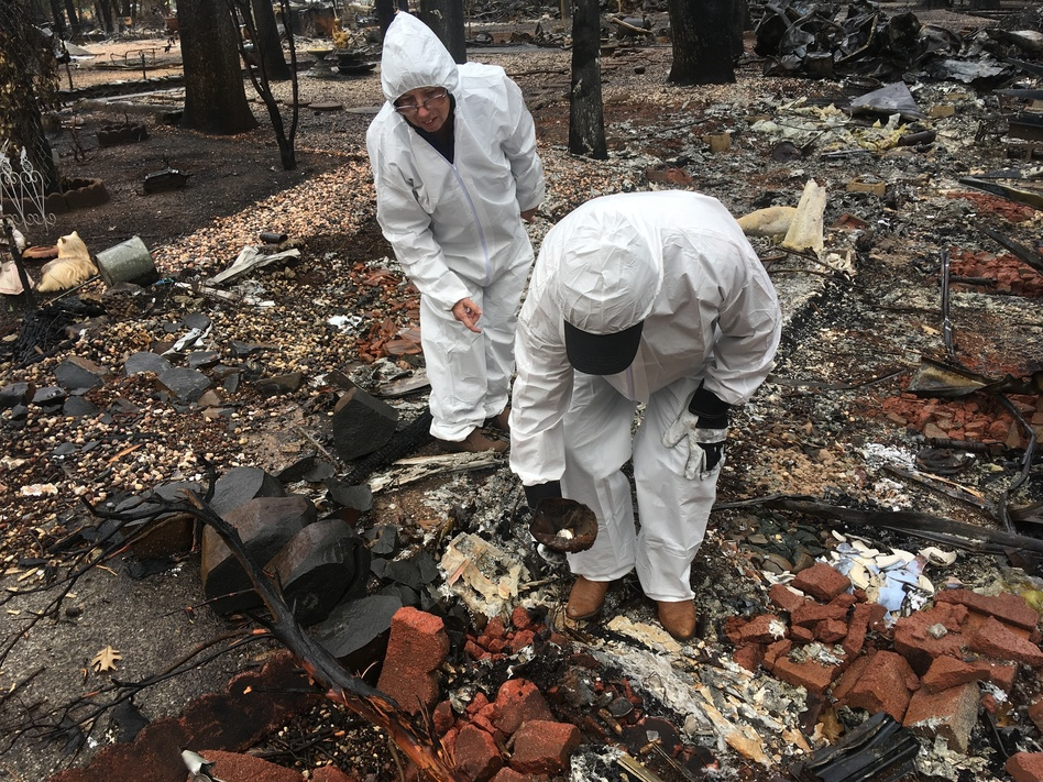 Jerry and Joyce McLean, wearing hazmat suits, look for sentimental items as they sift through the remains of their home Wednesday in Paradise, Calif. (Don Thompson/AP)