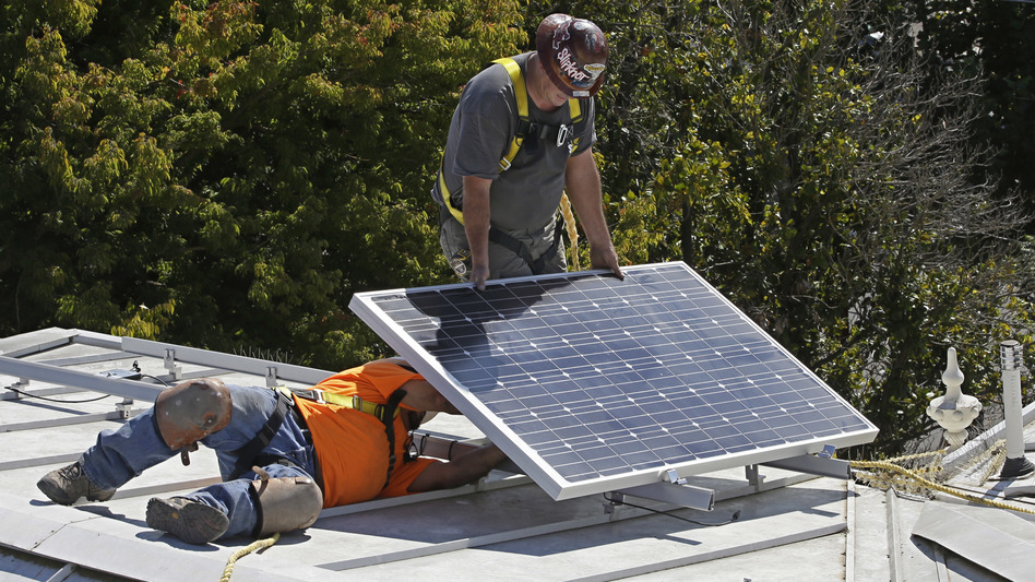 California predicts mandatory solar panel installations will add nearly $10,000 to the upfront cost of a home — money that will be recouped through energy savings. (Rich Pedroncelli/AP)