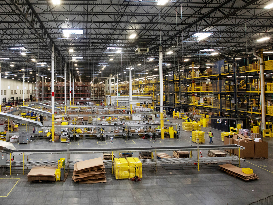 Workers at an Amazon fulfillment center in Robbinsville, N.J., were sickened on Wednesday after an automated machine punctured a can of bear repellent. The warehouse is seen here in June. (Bess Adle/Bloomberg via Getty Images)