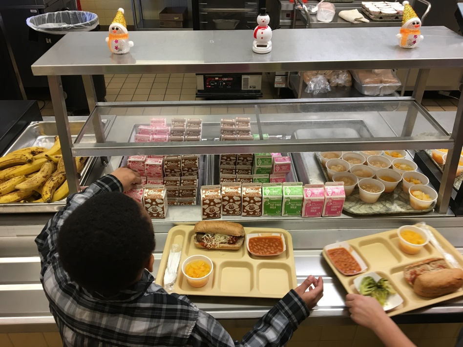 The Trump administration is giving schools more flexibility in the meals they serve. Critics say the rollback on school lunch rules is bad for kids' health. (Mary Esch/AP)