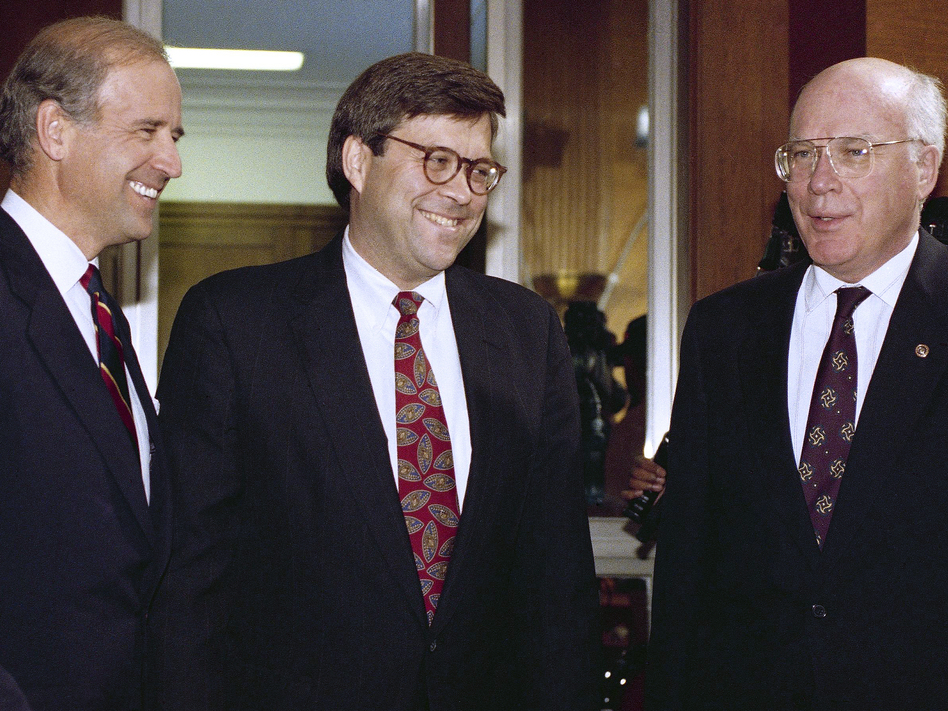 Attorney general nominee William Barr (center) chats with then-Sen. Joe Biden and Sen. Patrick Leahy, D-Vt., before Barr's hearing on Nov. 12, 1991. (John Duricka/AP)