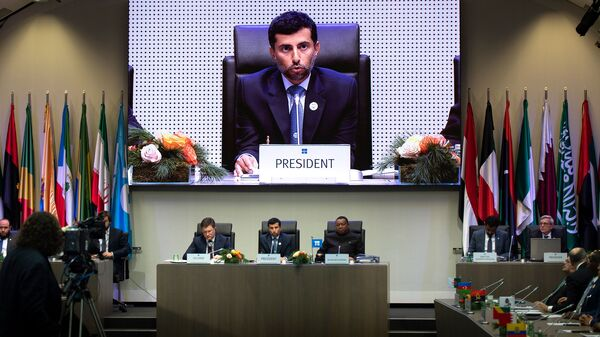 OPEC President Suhail al-Mazrouei speaks Friday at OPEC headquarters in Vienna. OPEC, Russia and other producers have agreed to cut production, ignoring pressure from President Trump.