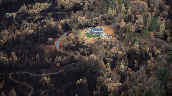 Just outside of Paradise, the charred remains of the Camp Fire stops just short of a home that survived the blaze.