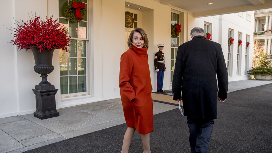 House Minority Leader Nancy Pelosi speaks to a reporter as she and Senate Minority Leader Sen. Chuck Schumer walk back into the West Wing after speaking to members of the media outside of the White House in Washington, D.C., Tuesday. (Andrew Harnik/AP)