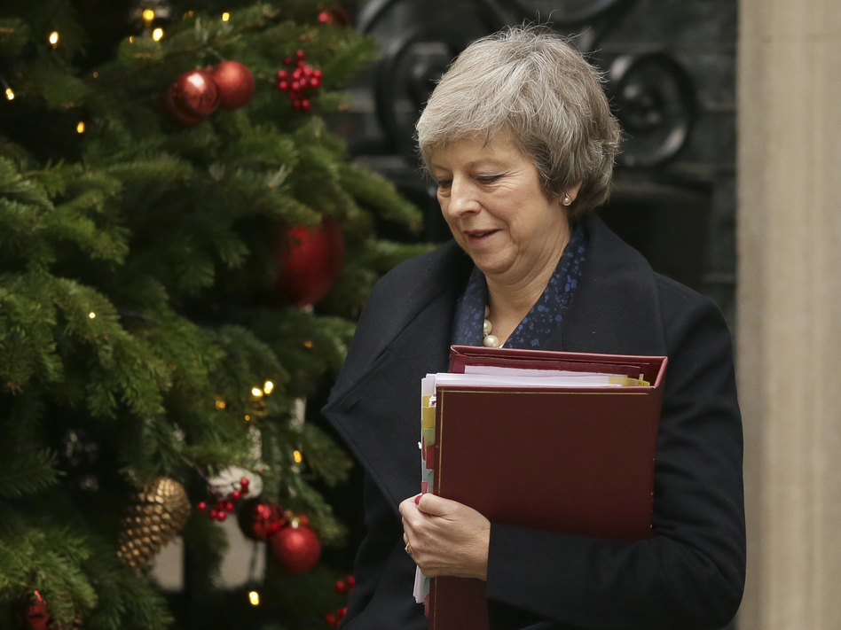 Britain's Prime Minister Theresa May leaves No. 10 Downing St. to attend the weekly Prime Ministers' Questions session on Wednesday. (Tim Ireland/AP)