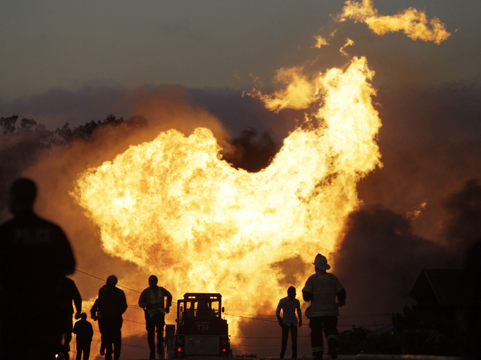 A massive fire roars through a neighborhood in San Bruno, Calif., after a PG&E gas pipeline ruptured, killing eight people, in 2010. (Paul Sakuma/AP)