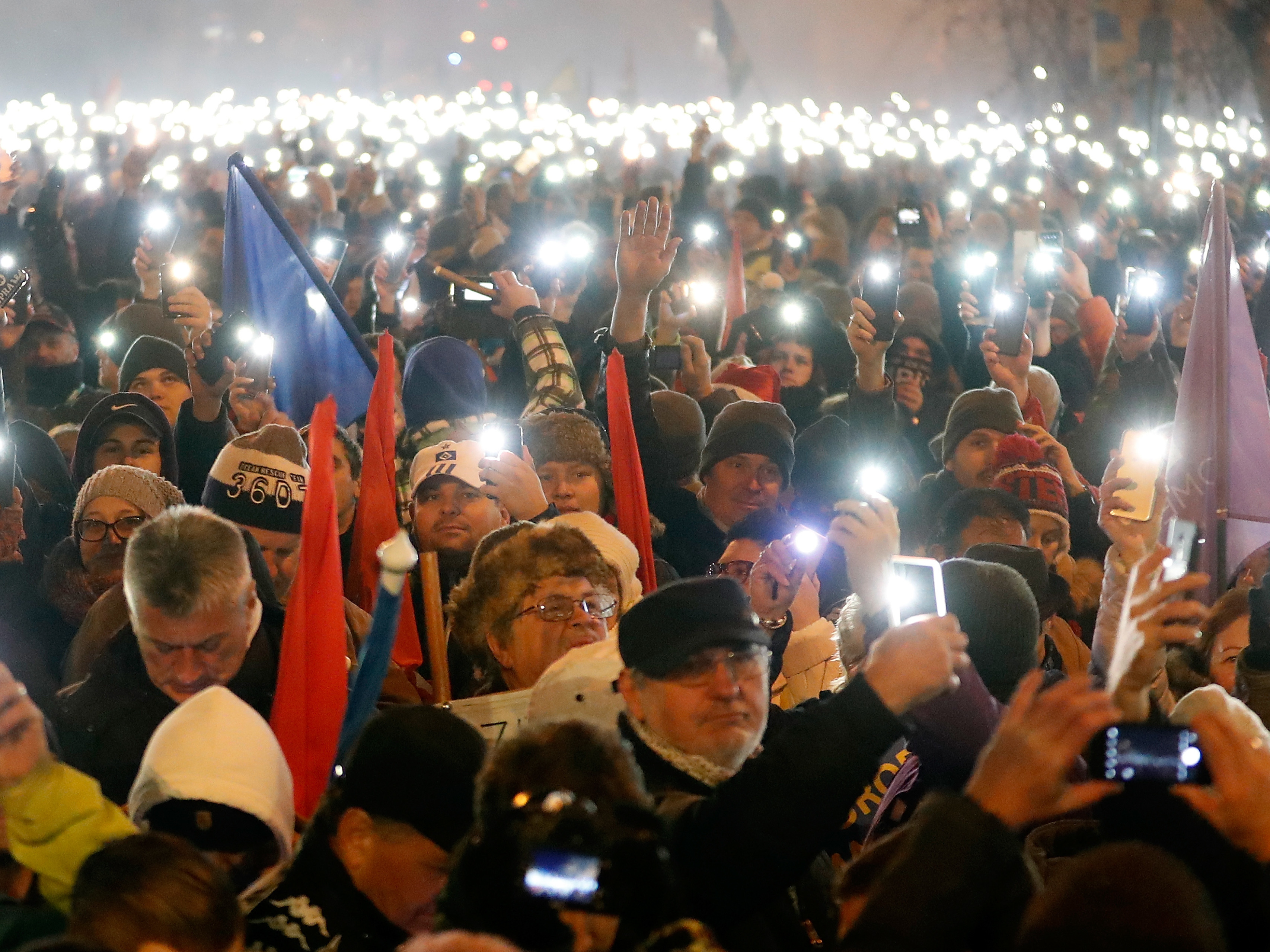 Demonstrators protesting against recent legislative measures introduced by the government of Hungarian Prime Minister Viktor Orbán stand outside parliament on Dec. 16, 2018 in Budapest, Hungary.