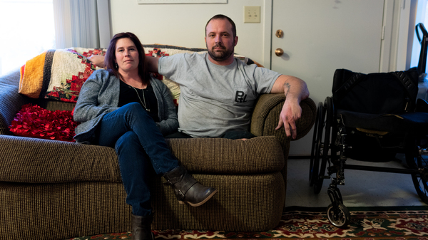 Ret. Sgt. Christopher Kurtz and his wife Heather Kurtz pose for a portrait on the couch in their living room on Dec. 10, 2018.