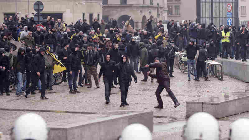 Protesters And Police Clash In Brussels At Rally Against UN Migration Pact