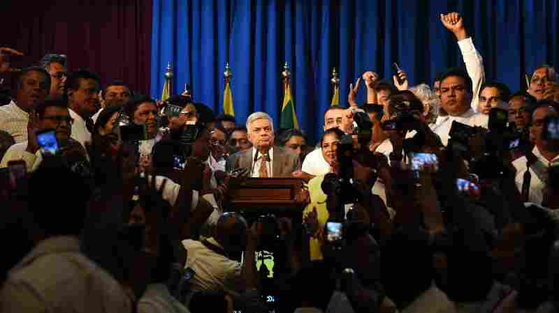Sri Lankan Prime Minister Celebrates His Reinstatement As 'Triumph Of Democracy'