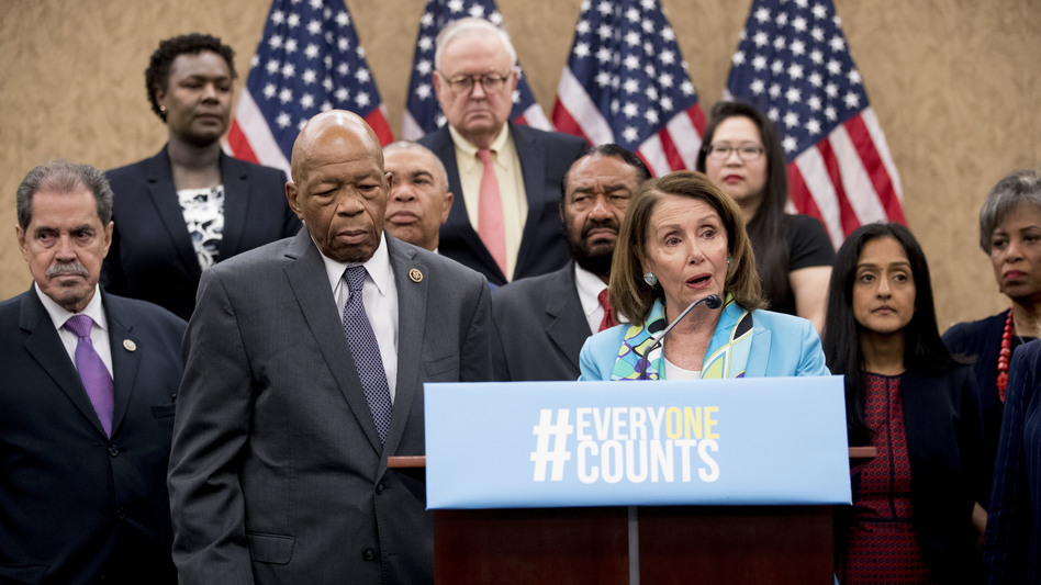 Nancy Pelosi of California, now House speaker, joins fellow Democrats, including Reps. José Serrano of New York and Elijah Cummings of Maryland, as well as other census advocates at a May 2018 press conference in Washington, D.C., about the new citizenship question on the 2020 census. (Andrew Harnik/AP)