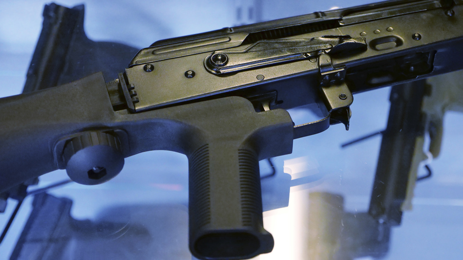 The Trump administration is moving to ban bump stocks, like the one attached to the rifle above, which allow semiautomatic weapons to fire rapidly. (Rick Bowmer/AP)