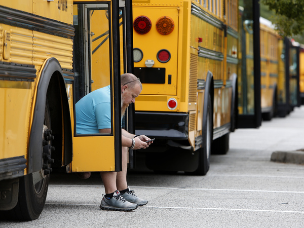 Jay McAbee, a bus driver with the Greenville, S.C., school district, waits by his bus in Charleston, S.C., in October of 2016, for word of when to start evacuating the city's residents in advance of Hurricane Matthew. Simply having enough buses to carry pets as well as people can be key to convincing residents they need to leave ahead of a big storm, emergency responders say.