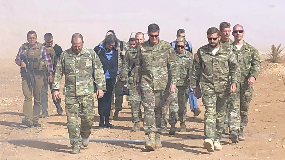 U.S. Gen. Joseph Votel (center), the top U.S. commander for the Middle East, visited a military outpost at al-Tanf in southern Syria, where the U.S. trains Syrian opposition forces, in October. President Trump is planning to withdraw the U.S. forces from Syria, according to a Pentagon official. (Lolita Baldor/AP)