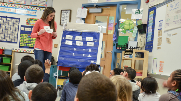 Cristina Scholl, first-grade teacher at Lincoln Elementary, uses a curriculum that mixes teacher-directed whole-class phonics lessons with small-group activities.