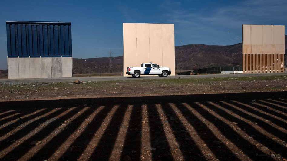 President Trump's wall prototypes are seen from behind the Mexico-US border fence in Tijuana, Mexico, on Dec. 12. With Congress unlikely to fund Trump's wall, Trump is floating other tactics. (Guillermo Arias/AFP/Getty Images)