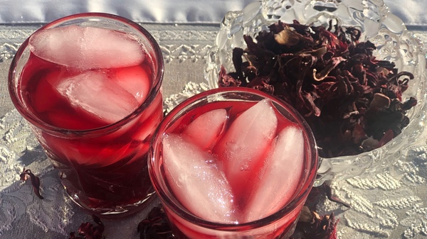 "Sorrel, a festive drink made by steeping hibiscus flowers, is the taste of the holidays throughout the Caribbean. It is also a close cousin to the African-American red drink, described as ""liquid soul."""