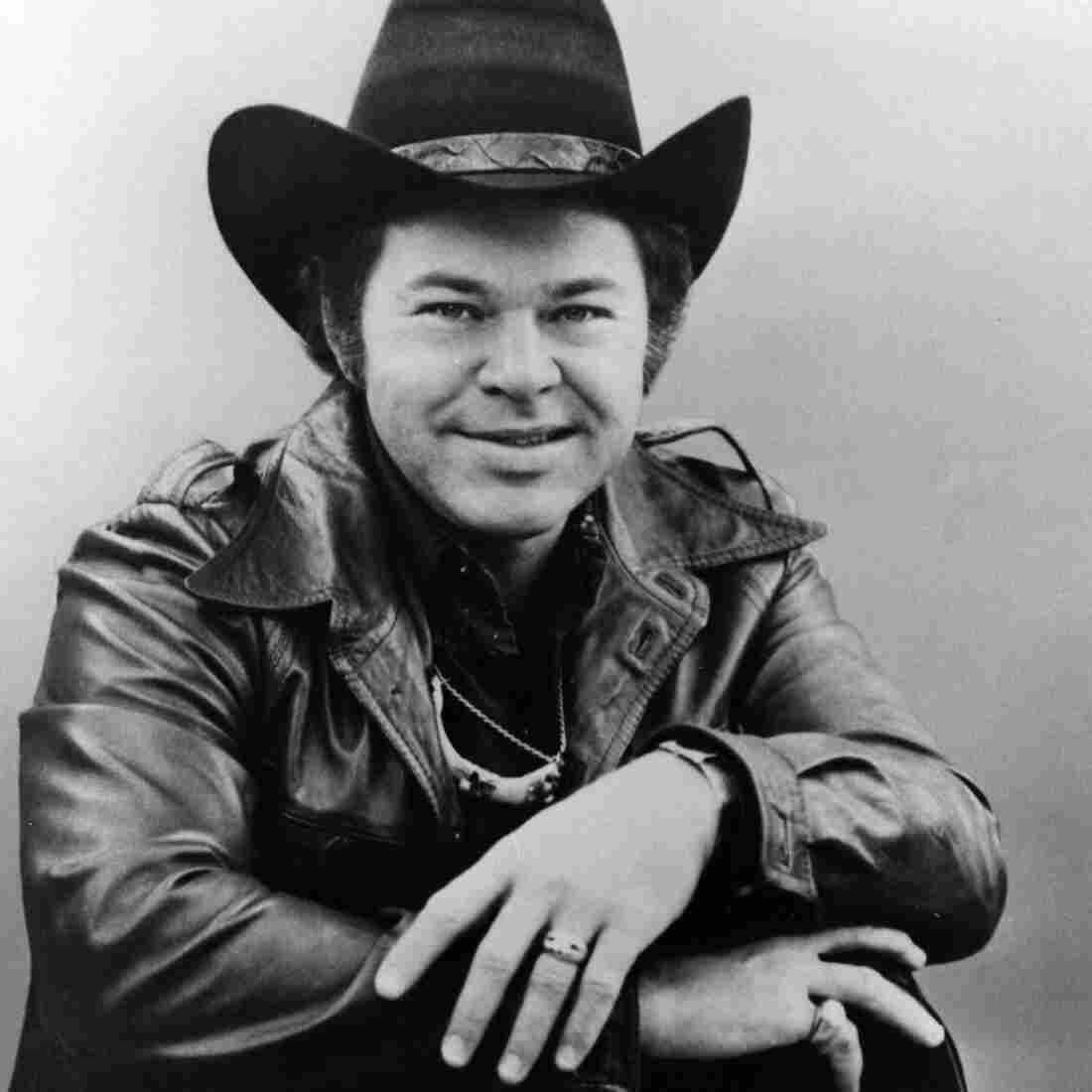 Roy Clark with his guitar circa 1973.