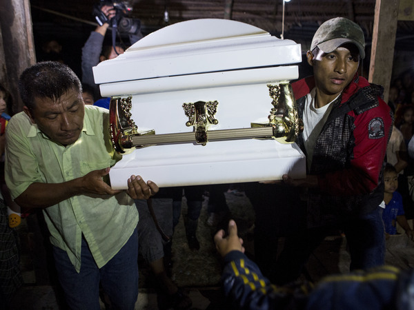 Neighbors carry the coffin that contains the body of Jakelin Caal Maquin into her grandparents' home in San Antonio Secortez, Guatemala. The 7-year-old girl died while in the custody of the U.S. Border Patrol.