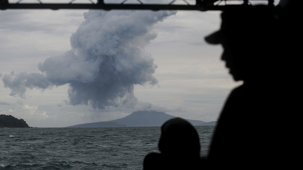 Indonesian Navy personnel watch as Anak Krakatau spews volcanic materials into the waters of Indonesia