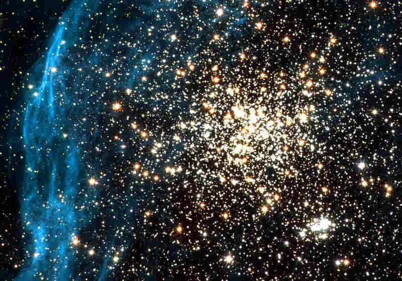 This image taken by the Hubble Telescope on July 10, 2001 shows two star clusters in a neighboring galaxy.