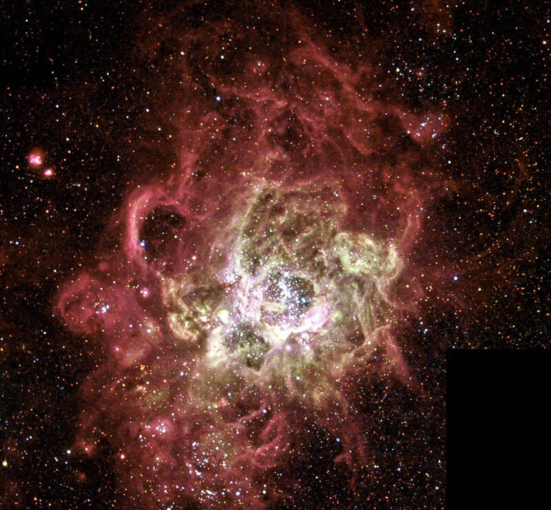 This image, released Dec. 4, 2003, shows the NGC 604 nebula, one of the largest known regions of star birth in a nearby galaxy.
