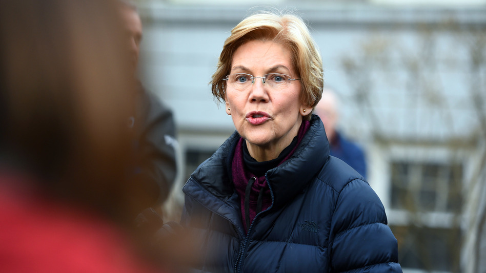 Massachusetts Sen. Elizabeth Warren speaks to reporters outside her home in Cambridge, Mass., on Dec. 31, after announcing plans to explore a campaign for the 2020 Democratic presidential nomination. (Meredith Nierman/WGBH)