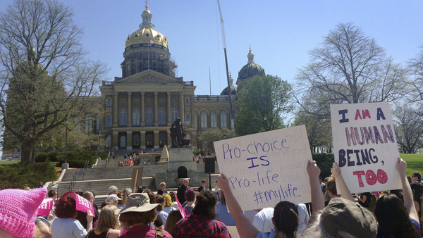 Abortion-rights advocates rally outside the Iowa capitol building in May. A law there banning abortion after a fetal heartbeat is detected is one of several state laws on its way through the courts.